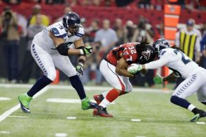 Jacquizz Rodgers' trucking of Earl Thomas would incur a 15-yard penalty under the new rule. (David Goldman)