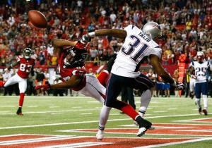 Aqib Talib batted the ball away from Roddy White to squash any chances of a comeback. (Kevin C. Cox)